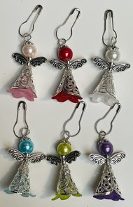 Steekmarkeerder engel met zilveren jurkje